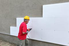 Construction site, styrofoam insulation drilling for anchor Stock Photos