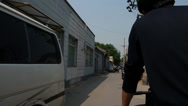 Stock Video Footage of a man driving a rickshaw bike in beijing china