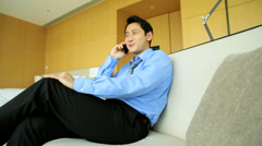 Ethnic Male Business Advisor Travel Hotel Room Relaxation Smart Phone - stock footage