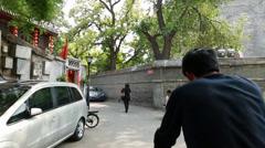 Man pedaling tourists in rickshaw bike in china Stock Footage