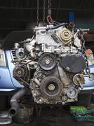 old diesel engine of light truck maintenance in garage service - stock photo