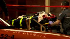 4K - Shooting victim carried into ambulance by firemen - stock footage