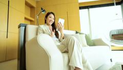 Female Ethnic Asian Chinese Relaxing Luxury Hotel Tablet Video Chat Stock Footage