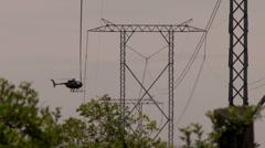 4K - Helicopter performing high voltage cable inspection Stock Footage