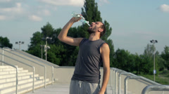 Young jogger drinking water after run, super slow motion, shot at 240fps HD Stock Footage