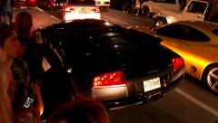 4K - Loud sports cars parade down public street - stock footage
