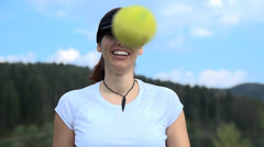 Female tapping tennis ball in front of camera in slow motion - stock footage