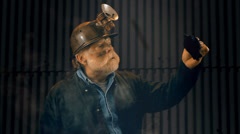Coal miner find dead bird canary Stock Footage