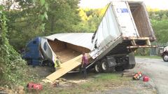 wide shot reveals full damage to semi trailer at scene - stock footage