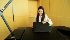 Young Asian Chinese Female Business Executive Smart Downtown Office Laptop Stock Footage