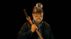 Coal miner turning on headlamp head lamp - stock footage