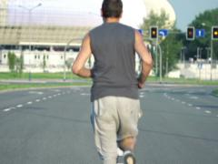 Man jogging on the street in the city NTSC Stock Footage