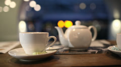 Pouring black hot tea into the cup Stock Footage