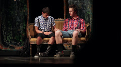Two college students playing on a theatrical performance, young men on stage Stock Footage