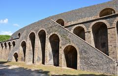 exterior of the pompeian amphitheatre. is classed as the oldest of all existi - stock photo