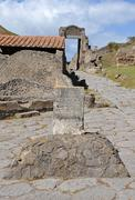 Stock Photo of boundary stone (cippus) of the ancient city of pompeii. cippus of titus suedi