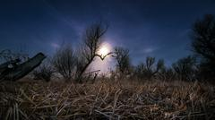 chasing the moon - night full moon landscape - stock photo