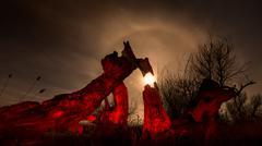 Stock Photo of burned tree - night full moon landscape