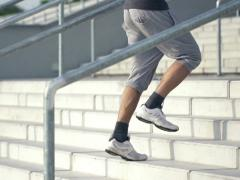 Man jogging up the stairs in the city, super slow motion, shot at 240fps NTSC Stock Footage