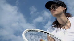 Low angle female tennis player with racket preparing - stock footage