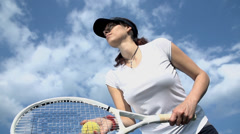 Beautiful tennis player serving ball in slow motion Stock Footage