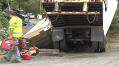Accident crew medium shot man cuts up wrecked goods Stock Footage