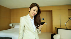 Asian Chinese Businesswoman Hotel Accommodation Smart Phone Technology Stock Footage
