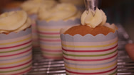 Stock Video Footage of Squeezing icing on to cupcake