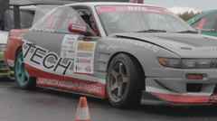 Racing car on the parking Stock Footage