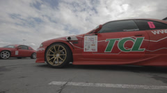 Racing car on the parking - filmed with dolly Stock Footage
