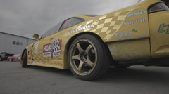 Yellow racing car on the parking - filmed with dolly Stock Footage