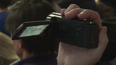 Amateur camera in hand men Stock Footage