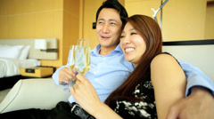 Attractive Asian Chinese Couple Travel Hotel Vacation Leisure Drinking Wine Stock Footage