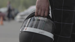Professional racer with helmet Stock Footage