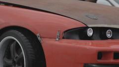 Headlights and bumper of racing car - filmed closeup Stock Footage