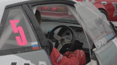 Racer sitting in a sports car - stock footage