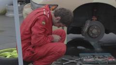 Racer repairs race car Stock Footage