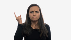 Woman angry and displeased on white background Stock Footage