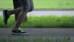 Woman legs jogging in the city, super slow motion, shot at 240fps HD Stock Footage