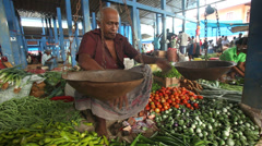 Local man selling and people buying at Hikkaduwa market. Stock Footage