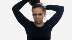 Not happy with own hair on white background Stock Footage