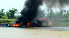 Ship burning on river Stock Footage