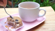 Stock Video Footage of Eating cake with tea in garden time lapse