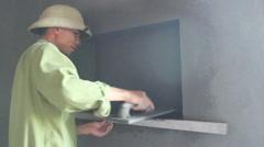 Floor tiles installation. Man installs ceramic tile Stock Footage