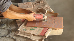 Worker cutting the tile by circular saw Stock Footage