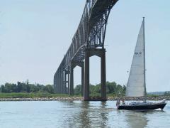 Sailboat under bridge Stock Footage