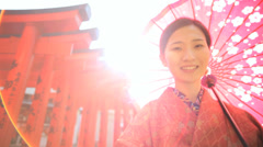 Asian Japanese Female Red Kimono Parasol Tourism Advertising Stock Footage