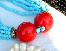 Red pearls of a two column light blue vintage for sale at flea market Stock Photos