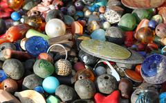 pendants for necklaces decorations handmade by a craftsman in african market - stock photo