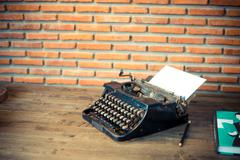 Vintage typewriter and a blank sheet of paper Stock Photos
